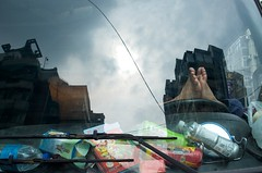 Cracked windshield (AntEater Theater) Tags: feet glass windows cracked broken construction naps sleeping breaks reflections clutter workingclass taipei taiwan streetphotography