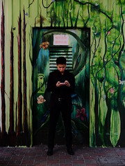 Street Jungle (Janka Takács Sipos) Tags: x20 fuji fujifilm xseries x series xtrans compact zoom cmos color colour hue chroma saturation colore couleur fotocromía цветная farbfotografie hong kong big city bigcity trees man mobile jungle wall asia streetart door streetphotography street streetphoto unposed urban urbanphoto streetscape urbanphotography streetphotographer public space candid stranger documentary people streets documenting photo photography rue calle strada ulica utcafotó strasenfotografie улица רחוב