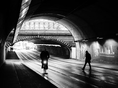 cross the street (Sandy...J) Tags: street streetphotography sw schwarzweis atmosphere tunnel urban underpass unterführung blackwhite bw black light darkness people photography fotografie noir monochrom menschen germany grafitti walking white walk biker winter mood deutschland olympus reflection