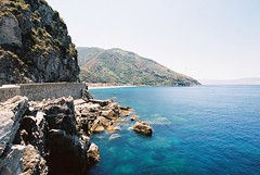 Scilla. Italy, June 17 (arsenterzyan) Tags: summer sun eos3 canon ektar100 kodak 1635 35mm film grain analog rocks cliff bay water scilla travel italy europe sea