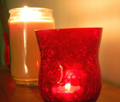 Illuminated Candles. (dccradio) Tags: lumberton nc northcarolina robesoncounty indoors inside candle candles burning illuminated flame redcandleholder candleholder tealightcandle jarcandle wall fire nikon d40 dslr tealight red light candlelight
