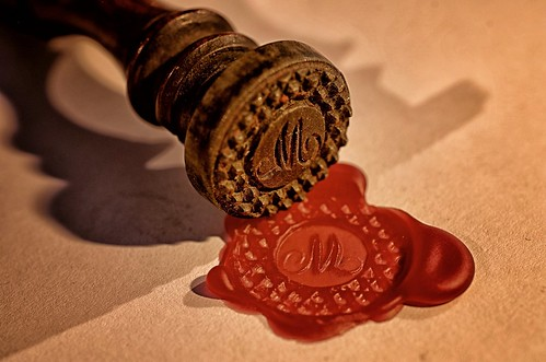 Candle wax seal lit by candlelight