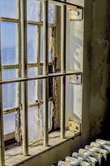 Some are destined never to leave. (katebosworth1) Tags: window prison bars metal radiator sony abandoned broken glass