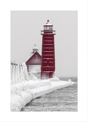 Grand Haven in December (DJ Wolfman) Tags: grandhavenmi michigan lighthouse red snow olympus olympusomd em1markii zuiko 300mmf4zuiko zd micro43