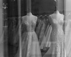 Bridal shop - img538 (T. Brian Hager) Tags: minoltax700 minolta x700 35mm epsonv600 epson scanned bw ilfordhp5plus400 ilford film window blackwhite analog dresses bridalshop roanokeva va virginia reflections gowns wedding weddinggowns mannequins