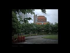 Glimpse (Antoine - Bkk) Tags: architecture design building darktable fujifilm tokyo japan national graduate institute for policy studies red orange