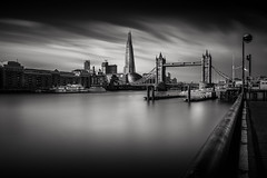 A view on the Tower Bridge (lja_photo) Tags: london towerbridge shard docks themse tower bridge theshard stkatharinedocks river water reflections city clouds contrast cityscape light natural architecture architectural long exposure longexposure black blackandwhite bw bnw blackandwhitephoto building buildings white monochrome monotone monoart moody sky street streetphotography photography skyline