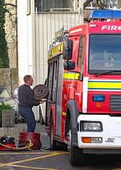 217 of Year 4 - Humping hoses on to the truck (Hi, I'm Tim Large) Tags: portishead fire engine truck tender load loading hoses tidy henryhoover red man male guy hero fuji fujifilm xf xpro2 35mm f14 fireman maintenance cleaning clean