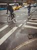 Modes of transport (Vincent F Tsai) Tags: street streetphotography urban city bicycle taxi bus car newyorkcity nyc rain cold crosswalk cyclist panasonic lumixg14mmf25 lumixgx8