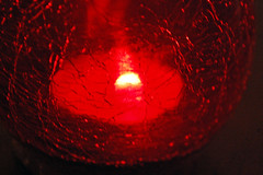 Red Candle Holder With Tealight Candle. (dccradio) Tags: lumberton nc northcarolina robesoncounty indoors inside candle candles burning illuminated flame redcandleholder candleholder tealightcandle fire nikon d40 dslr tealight red light candlelight