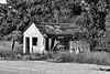 052715-536F (kzzzkc) Tags: nikon d7100 usa missouri rural abandoned building interesection mo2 mo13 gravel bw