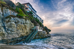 The Tide is High (tquist24) Tags: california hdr lagunabeach nikon nikond5300 pacificocean weststreetbeach beach cliff clouds geotagged hightide house ocean sand sky stairs water unitedstates boat an ideal location