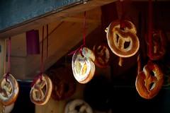 a Ray of Light on bretzel (moniq84) Tags: bretzel bread sun sunny day light ray wood winter christmas xmas merano meran trentino alto adige sud tirol food red
