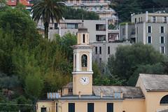 L'orologio della chiesetta tra la campagna e i palazzi (explored) (Carla@) Tags: liguria italia europa mfcc canon supershot