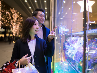 Young wife and husband  shopping in Christmas night