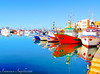The Colours on the Water (Francesco Impellizzeri) Tags: port trapani sicilia italy water reflections canon landscape boats