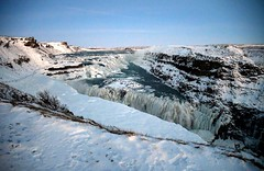 Overlooking the near fully frozen Gullfoss Waterfall in Iceland. (One more shot Rog) Tags: iceland reykjavik coldest cold ice icicles frozen waterfall gulfoss gullfoss gullfosswaterfall freezing goldentriangle olfusa olsusariver canyon canyons falls goldenfalls