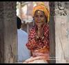Woman on temple step greeting Namaste, Kathmandu, Nepal (jitenshaman) Tags: travel destinations worldlocations asia asian nepal nepali kathmandu bhaktapur durbarsquare namaste prayer hands greet greeting namaskar handsfoldedinprayer hindu warmth woman oldwoman tradition traditional devout greets welcomes welcoming turban wooden temple temples