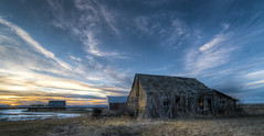 Abandoned Blues (Rustic Lens Photography) Tags: clouds grangeville rustic sunset abandoned camas decay dramatic grass homestead house idaho mud old prairie shack sky sunrise usa winter farm farming rural country blue orange sun snow
