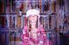 Merry Christmas! (DannyOKC) Tags: plasticfantastic santahat bookshelf books bookshelves homedeveloped c41 35mm holga k200nm fuji superia iso400 toycamera