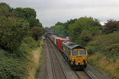 66519 - Wilnecote (Andrew Edkins) Tags: 66519 class66 shed freightliner wilnecote staffordshire england uk railwayphotography intermodal freighttrain diesel locomotive canon bridge geotagged august summer 2017 boxes containers type5 light trees railway track