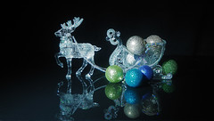 sleigh ride (Smiffy'37) Tags: christmas decorations baubles sparkle glitz stilllife objects reindeer sleigh reflections