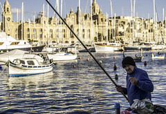 Fishing along Valletta'a harbor