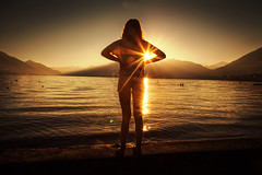 Happy New Year! (Chrisnaton) Tags: sunset sundown sunray girl lagomaggiore ticino landscape coast riverside silhouette minusio