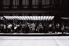 Waiting (OzGFK) Tags: australia melbourne city cbd people waiting tramstop transport transit sunny summer hot bw blackandwhite film analog nikon nikkor bourkestreet urban streetphotography 35mm