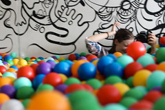 Action shot (Josiedurney) Tags: summer eastlondon summerinthecity londonlife fun hipster cool birthday towerhamlets university colour ballpit balls child children play boxpark shippingcontainer shoreditch girl cute smile camera action