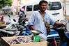 9916 (Vladimir_Shish) Tags: shopkeeper fish food bike libra