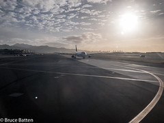 171206 NRT-HNL-05.jpg (Bruce Batten) Tags: usa aircraft subjects transportationinfrastructure buildings atmosphericphenomena businessresearchtrips sun automobiles trips occasions celestialobjects urbanscenery reflections cloudssky airports hawaii locations vehicles airplanes honolulu unitedstates us