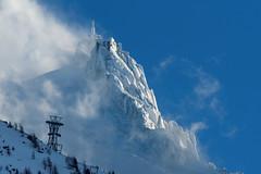 Brève éclaircie à l'Aiguille du Midi (Jean-Philippe Azaïs) Tags: aiguilledumidi chamonix montblanc snow cold mountain high cloud montagne ciel alps storm tram cable pylone