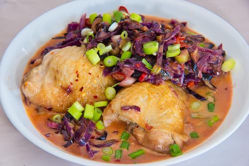 Chicken thighs in stir-fried cabbage