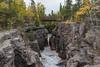 Hidden Falls Bridge II 1s (Greg Riekens) Tags: autumn usa bridge fallcolors temperance temperanceriverstatepark nikond500 hiddenfalls northshore rapids temperanceriver midwest fall statepark minnesota