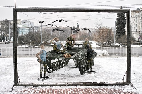 DP2M7529. Sculpture Comprising 6(7?) Crows, 5 Men, and a Tracked Military Vehicle Seen through a Picture Frame