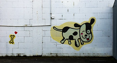 Bone Luv (Steve Taylor (Photography)) Tags: animal dog art graffiti streetart black red white yellow happy fun smile smiling newzealand nz southisland canterbury christchurch newbrighton bone heart tongue
