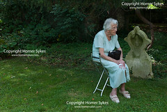 SENIOR ELDERLY WOMAN TIRED EXHAUSTED UK (Homer Sykes) Tags: senior oap older person woman elderly people graveyard cemetery cudham village summer fete kent uk britain british english england 2017 2010s