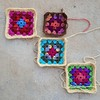 The first four granny squares (crochetbug13) Tags: crochetbug crochetsquares grannysquares crochetblanket crochetafghan crochetthrow roseanne roseannereboot roseannesofablanket crocheted crocheting scrapyarn yarnstash