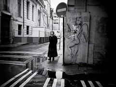 Deux Anges (Feldore) Tags: french paris angel candid contemplative graffiti puddles street woman îlesaintlouis feldore mchugh em1 olympus 17mm 18
