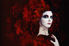 Madame Red (Spoken in Red) Tags: redflowers flowersinhair highfashion fashionportrait fineartportrait paleskin couture vibrantred alabasterskin fantasyportrait spokeninred