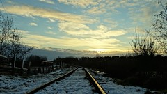 Sun setting over the rails at Norton Lakeside halt (eucharisto deo) Tags: winter canock chase heath railway chasewater country park staffordshire snow sky cloud sunset norton lakeside halt