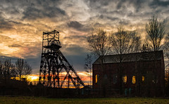 Astley Colliery Sunset Xmas Eve 2017 (Mister Oy) Tags: davegreen oyphotos ©oyphotos sunset fujix100f light mining heritage pit coal astleycolliery museum clouds night orange red history localhistory leigh wigan windows sunlit silhouette