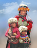 Flowery hats in Pisac - Cuzco (Lewitus) Tags: pisac cuzco hats people traditionalclothing 2006