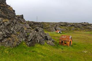 Two little rusty houses in Hvassahraun, Iceland