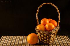 Oranges in basket.jpg (mraderstorf) Tags: texture citrus d700 nikon 150mm basket orange negativespace placemat skin brown fruit wicker clemintine 365project project365 wood 365 food wood3654