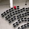red riding hood (jim_ATL) Tags: art museum atrium black chairs red coat atlanta abstract