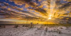 Sun Rays Through The Clouds (Stuart Schaefer Photography) Tags: sonyflickraward goldenhour cloudscape sunset travel outdoor clouds outdoors seascape sonya9 sonyalpha pensacolabeach florida sky landscape