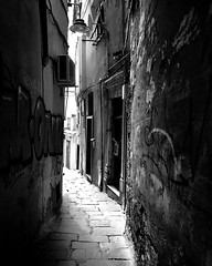 """Behind The Corner"" (giannipaoloziliani) Tags: blackandwhite biancoenero paint extremeblack noir nero black extreme ruins urbanapocalypse apocalypse oldstreet old flickr scritte muri walls written alleysofgenoa vicolidigenova vicoli alleys periferia periphery suburbs street nikonphotography nikond3200 nikoncamera nikon strange hard capturestreets capture liguria genova genoa sunlight luce ombre italy italia misterioso mysterious mistery mistero oscuro scuro shadows light buio obscure obscurity dark darkness lightandshadow streetphotography"