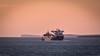 Sunrise Sailing (MBDGE 1Million+Views) Tags: orkney sts tanker scottspirit shuttle sunrise departure lighthouse sky calm scapaflow sea boat landscape seascape wave canon sailing sunrisesailing